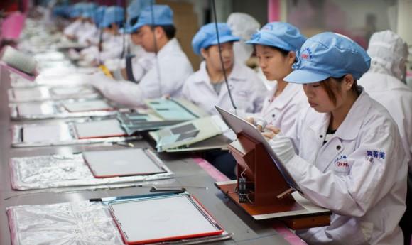 Arbeiter im Werk eines Apple-Zulieferers in Shanghai. Bild: Apple