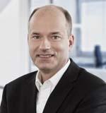 """""""Das erste umfassend hochsichere kommerzielle off-the-shelf-Smartphone"""". Secusmart-Geschäftsführer Hans-Christoph Quelle. Quelle: Secusmart."""