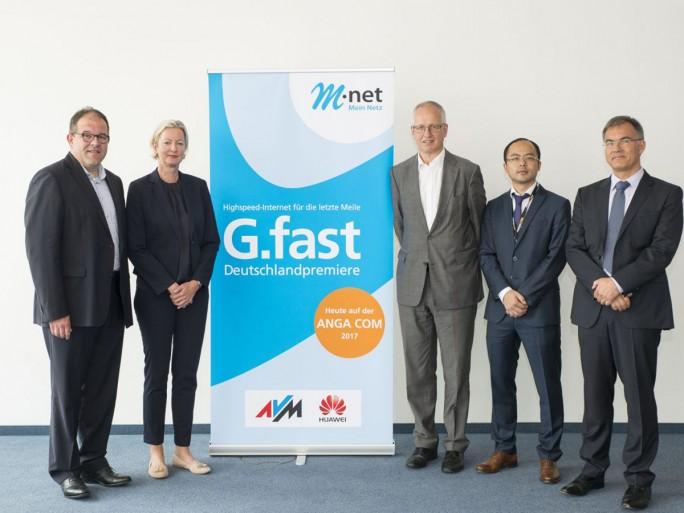 Auf der Fachmesse ANGA Com haben Vetreter von M-net, Huawei und AVM den Startschuss für G.fast in Deutschland gegeben  (Bild: M-net)